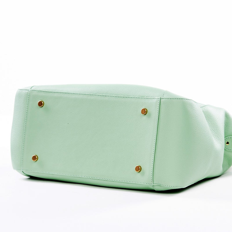 Frankie Lou Joann pistachio leather diaper bag showing studs to protect bottom of bag
