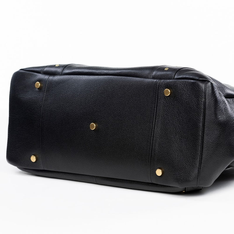 Frankie Lou Ivonne convertible leather diaper bag in black bottom view showing studs to protect leather