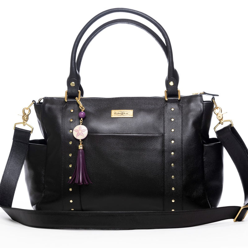 Frankie Lou Ivonne convertible leather diaper bag in black showing cross-body strap