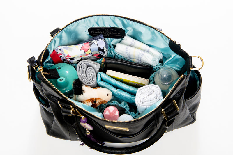 Frankie Lou Ivonne convertible leather diaper bag in black showing how to pack inside pockets