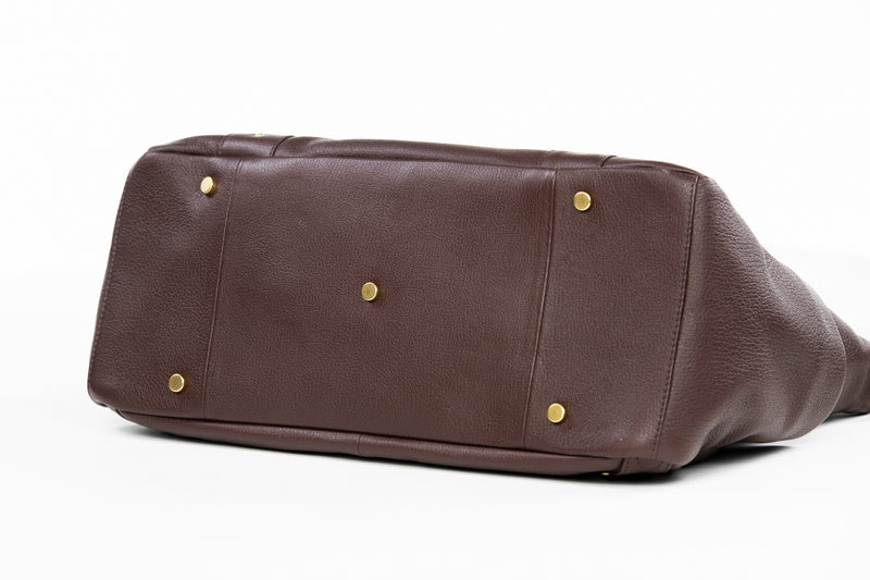 Frankie Lou Ivonne convertible leather diaper bag in brown bottom view showing studs to protect leather