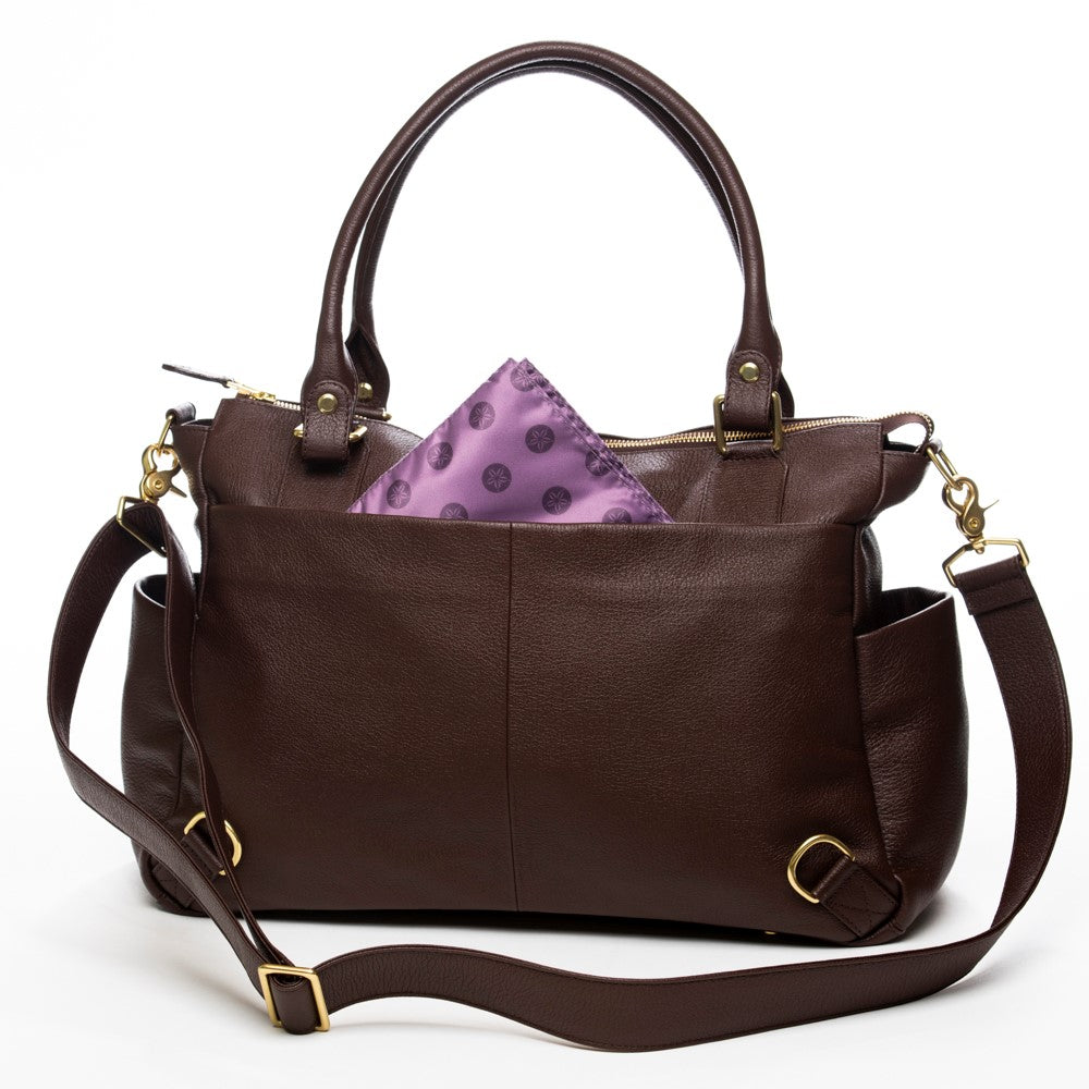 Frankie Lou Ivonne convertible leather diaper bag in brown with purple lining