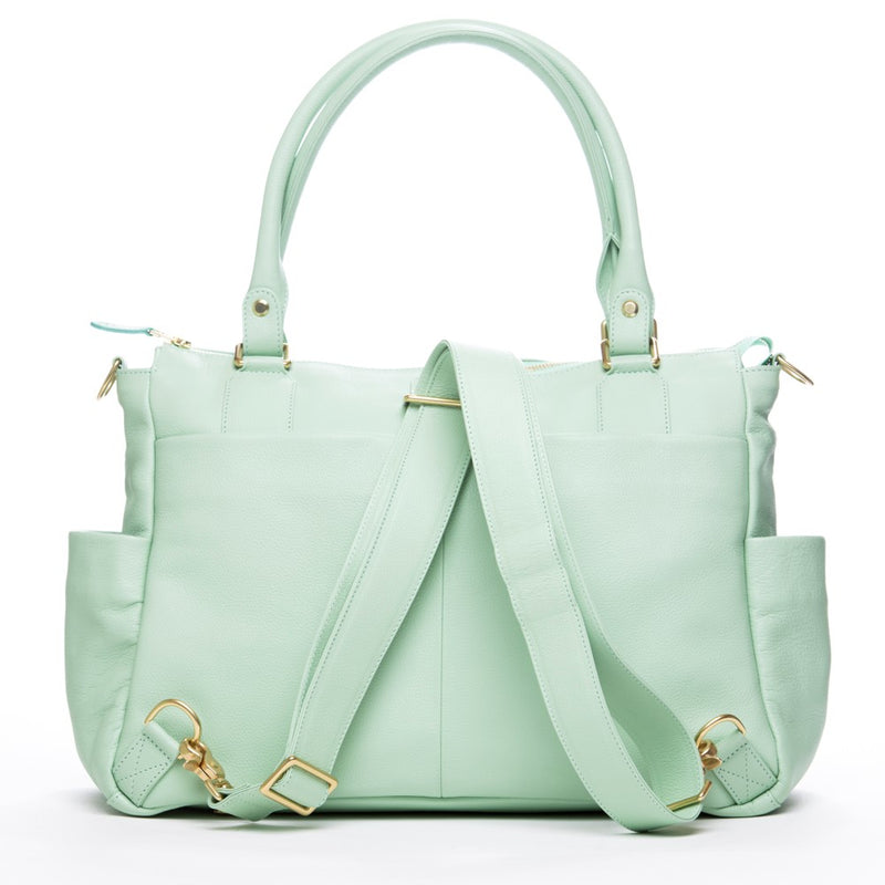 Frankie Lou Ivonne convertible leather diaper bag in pistachio showing it as a backpack