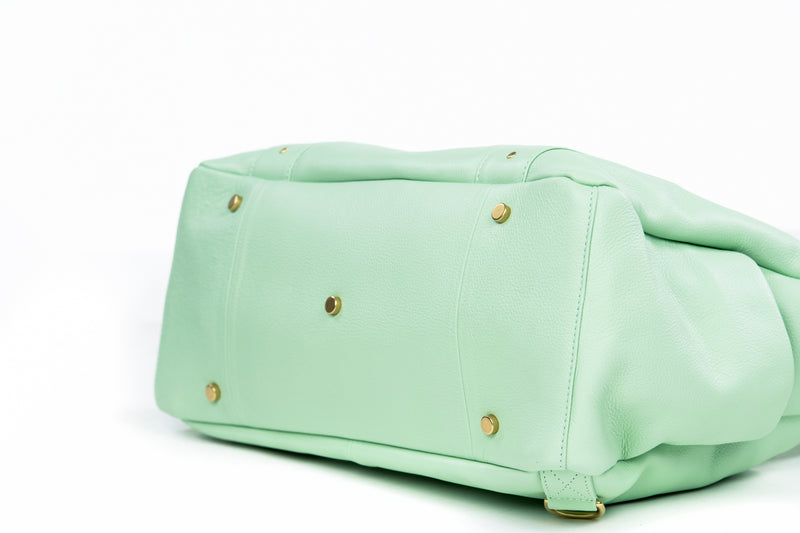 Frankie Lou Ivonne convertible leather diaper bag in pistachio bottom view showing studs to protect leather
