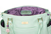 Frankie Lou Ivonne convertible leather diaper bag in pistachio with purple lining