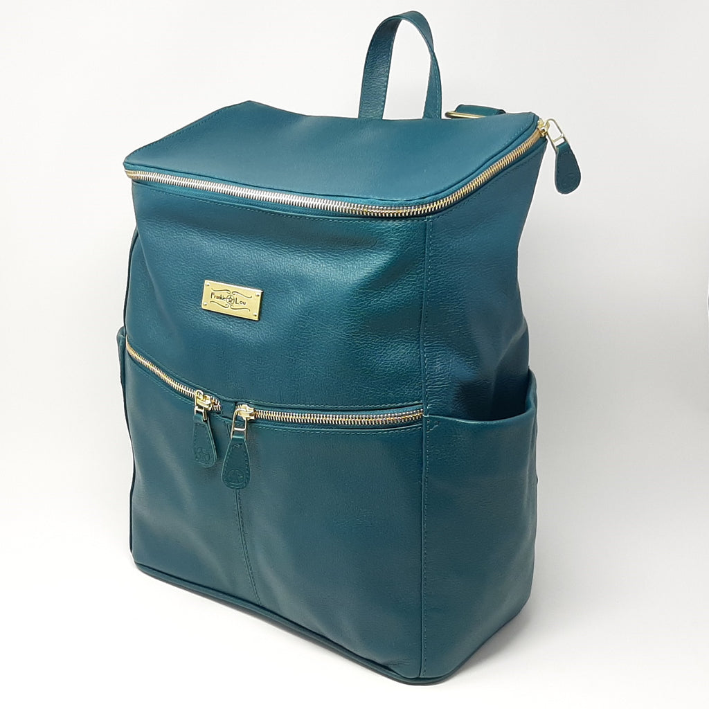 Frankie Lou Maria leather diaper bag backpack in spruce with zippered front pockets