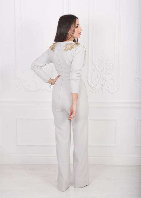 Jumpsuit with gold floral appliques