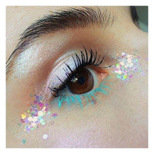Product photo of white irridescent chunky glitter being used as eye makeup