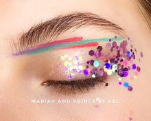 Product photo with holographic purple chunky festival glitter used as eye makeup