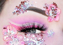 Product photo of pink and silver chunky glitter being used as eye makeup