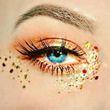 Product photo with holographic gold and red chunky festival glitter used as eye makeup