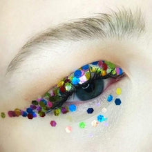 Product photo of Kiss & Glitters multi-coloured rainbow chunky festival glitter used as makeup