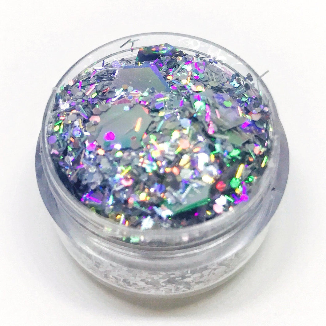 Product Photo Close up of Kiss & Glitter Super Chunky Holographic Silver and iridescent Chunky Festival Glitter Cara