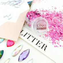 Product Photo with packaging of festival face gems and  holographic purple chunky festival glitter by Kiss & Glitter