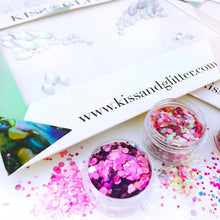 Product Photo with packaging Close up of Purple and Pink Chunky festival glitter and iridescent one piece stick on festival face gems by Kiss and Glitter
