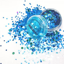 Product photo with packaging close up of turquoise and holographic blue chunky festival glitter by Kiss and Glitter