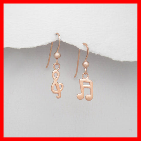 Earrings; Rose-gold Sol key