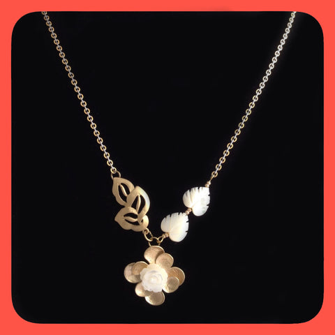 Necklace, mother of pearl and gold plated leaves