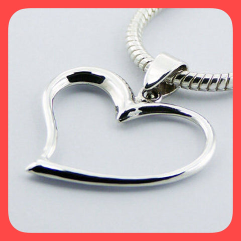 Pendants; Sterling silver asymmetrical open floating heart