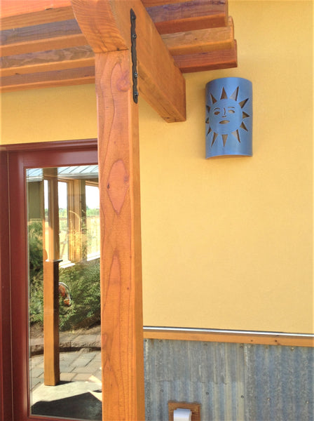 Blue Sunface Sconce on gold wall Clayworks Studio/Gallery