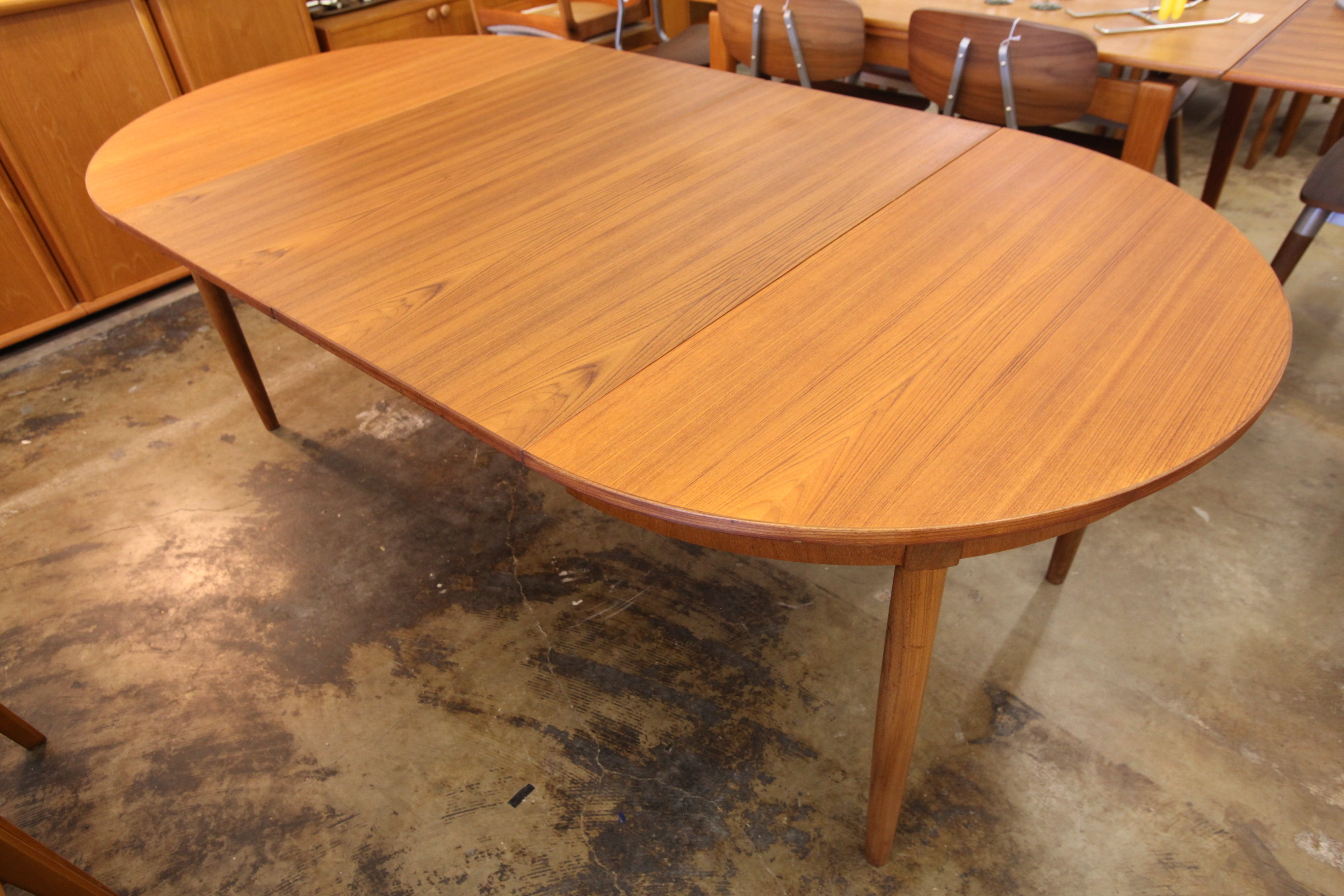 "Vintage Teak Dining Table W/ 2 Leafs (82""L x 43.25""W) or (43.25"" Dia Round)"