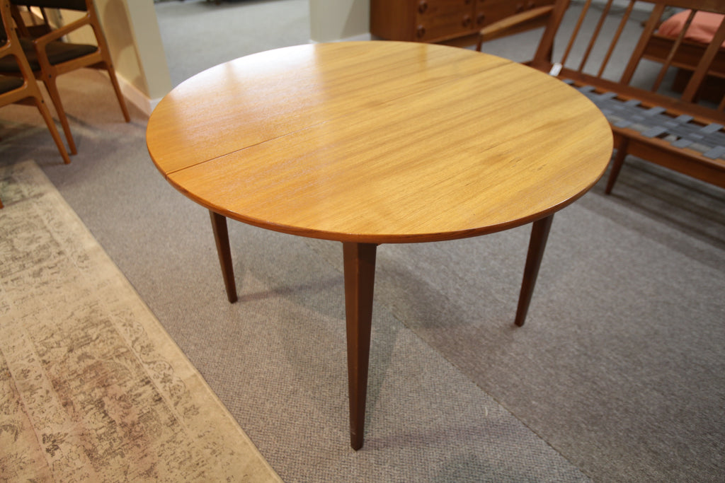 "Teak Round Table w/leaf (64.5""x43.5"")"
