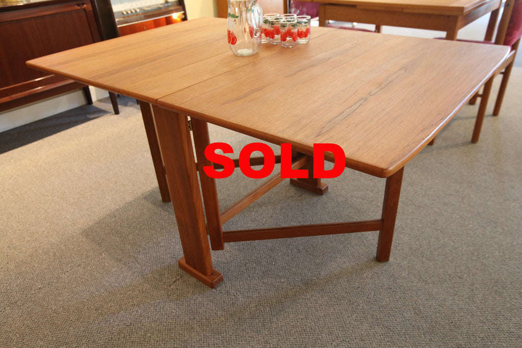 "Fold Out Teak Table (55""L x 35""W x 29''H)"