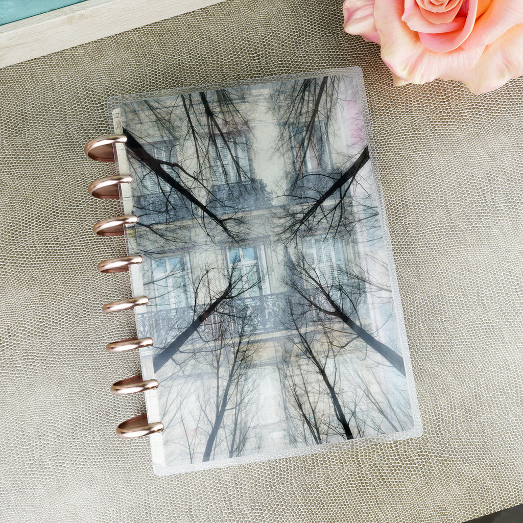 Trees translucent vellum planner cover by Jane's Agenda® over the Parisian cardstock dashboard with aluminum binding discs in Rose Gold.