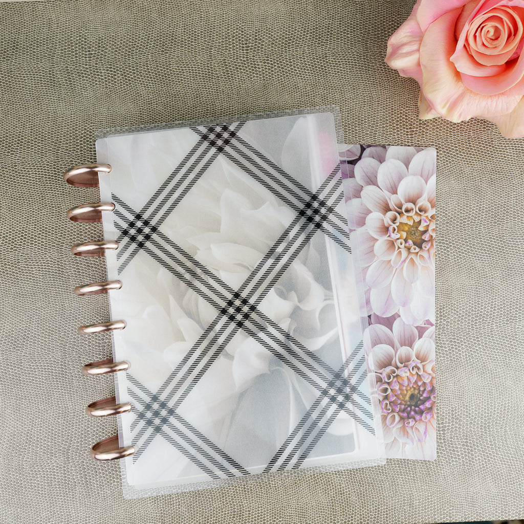 Plaid laminated vellum cover by Jane's Agenda® over the Soft Floral cardstock dashboard with Rose Gold binding discs.