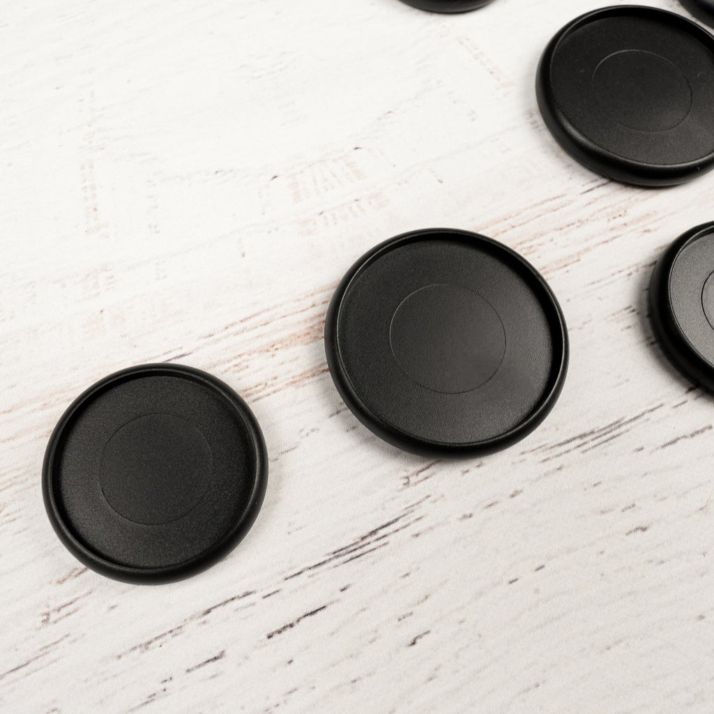 Plastic binding discs in Matte Black for discbound planner systems from Jane's Agenda®.