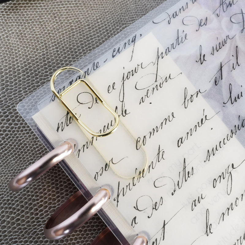 Gold Metal Pen Clip on a French Handwriting discbound cover from Jane&