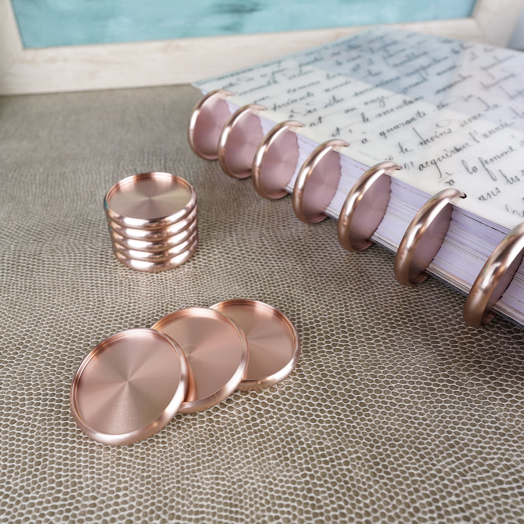 Rose Gold Aluminum Binding Discs from Jane's Agenda® featuring the French Handwriting cover on a discbound planner.