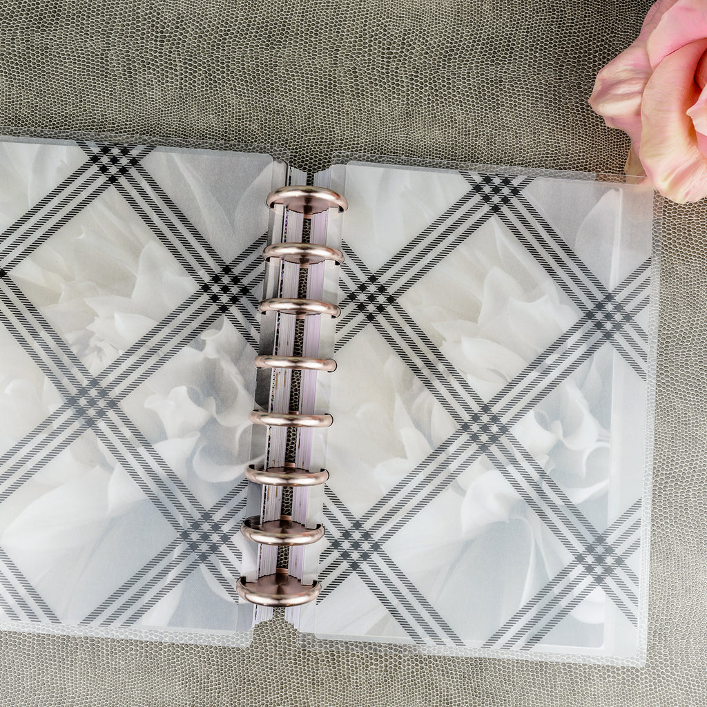 Plaid laminated vellum cover, front and back, by Jane's Agenda® over the Soft Floral cardstock dashboard with Rose Gold binding discs.