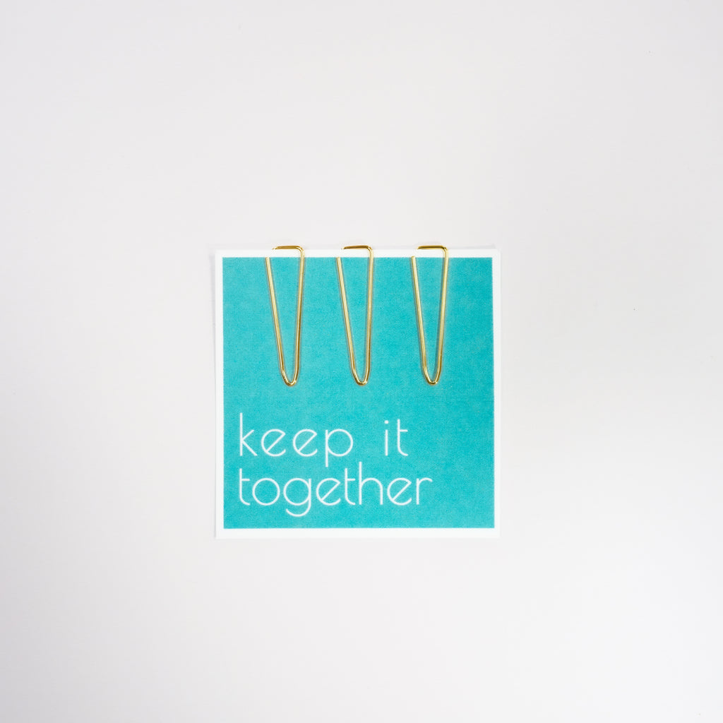 Gold paper clips with a quote card included in planner accessories by Jane's Agenda.