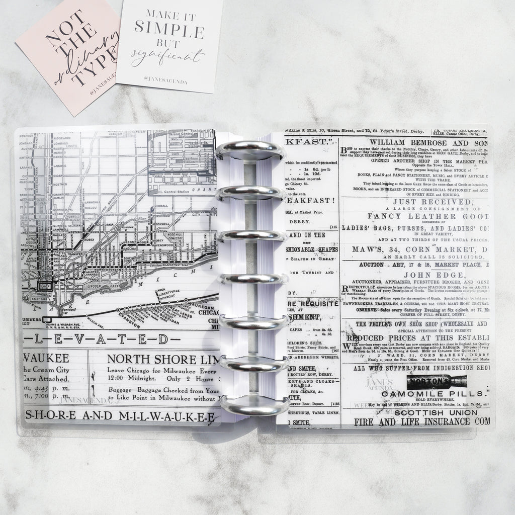Vintage Newspaper Vellum Planner Cover by Jane's Agenda® on a discbound planner system with silver metal binding discs