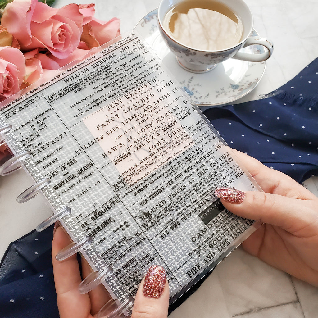 Translucent Vellum Planner cover Vintage Newspaper by Jane's Agenda® layered over the Neutral Dividers with a discbound planner system.