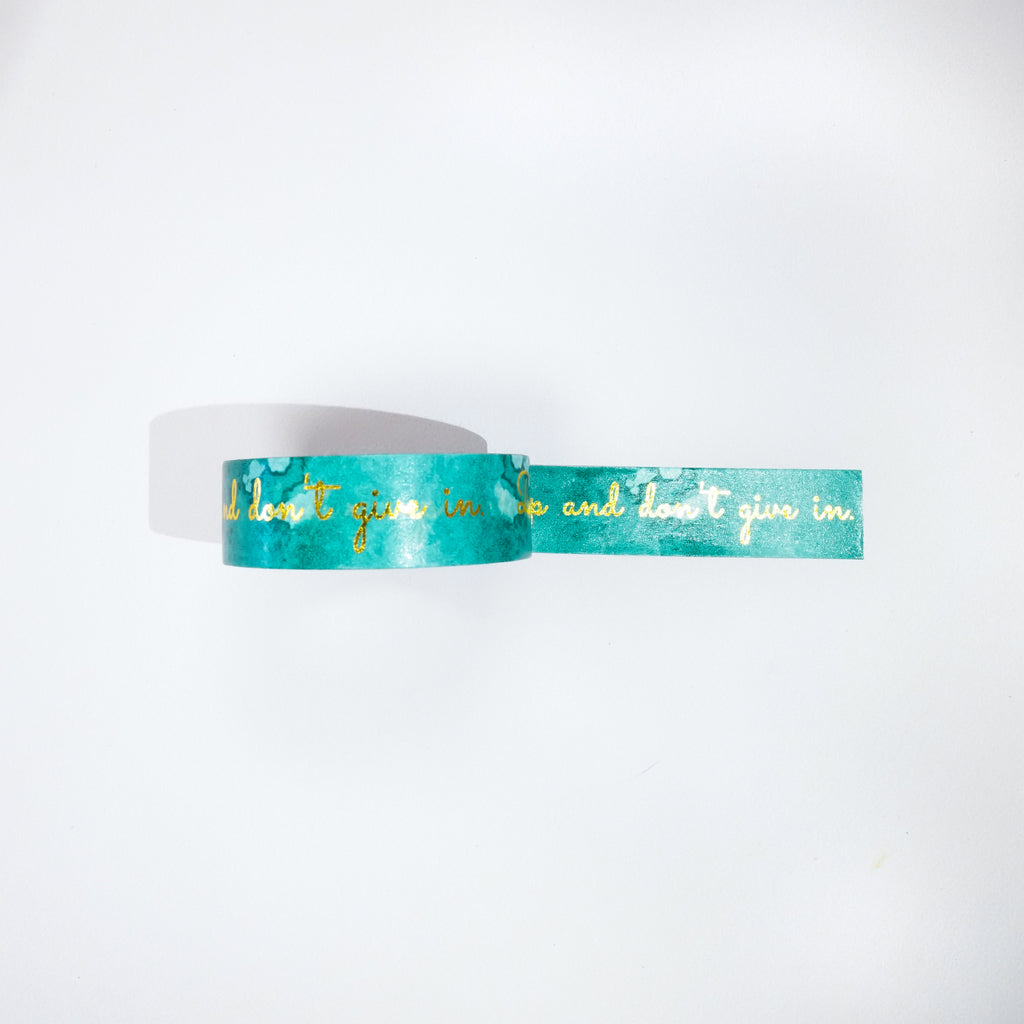 Teal colored Washi Tape with gold foiled font that reads 'Don't give up, and don't give in.' in accessories by Jane's Agenda.