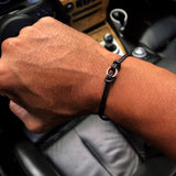 Black Sterling silver leather ring bracelet with gunmetal hematite ring and magnetic clasp.