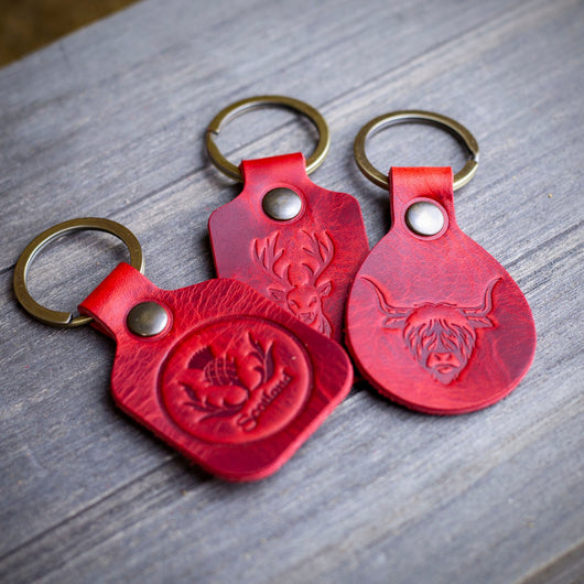red leather highland cow stag thistle key chains