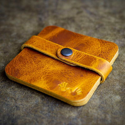 handcrafted tan leather coaster set