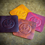 handcrafted full grain and vegetable tanned leather colourful coasters from scotland