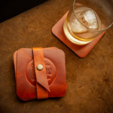 handcrafted full grain and vegetable tanned leather coaster set with scottish thistle