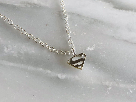 Tiny Sterling Silver Supergirl Necklace | Silver Sculptor