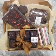 chocolate and caramel care package with honey sticks