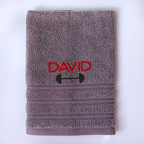 Grey gym towel or sports towel personalised with a name and dumbbell weight bar