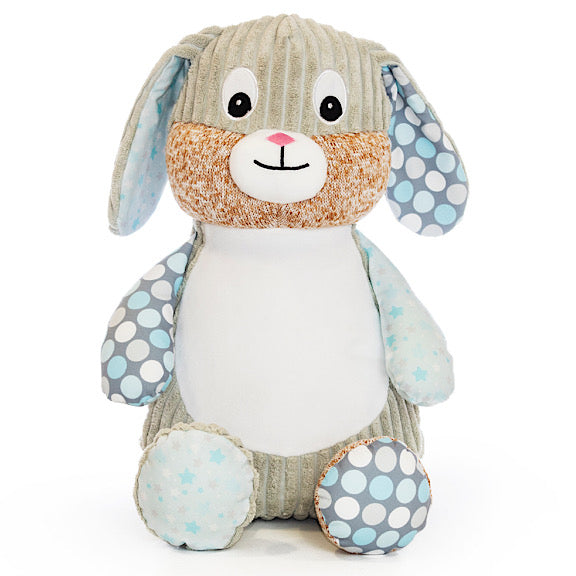 Grey bunny plushie teddy with accent fabric on legs and ears of blue spots and stars, with a white belly ready to be personalised