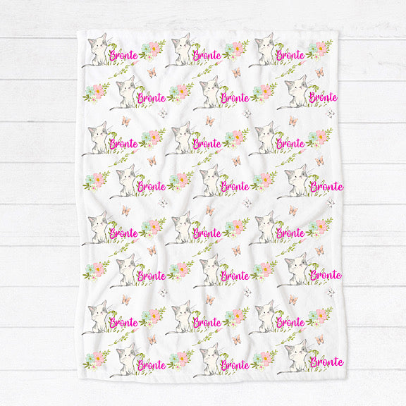 Fleece minky blanket with white and grey kittens surrounded by pastel floral bouquets and butterflies personalised with a name in bright pink
