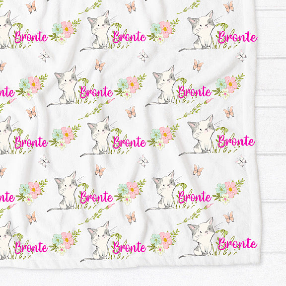 Fleece minky blanket with kittens surrounded by pastel flowers and butterflies personalised with a name