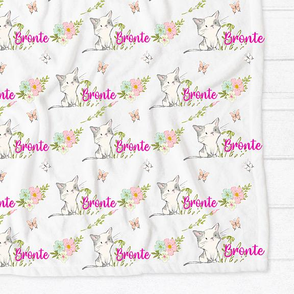 Minky fleece pram cot single bed blanket with white background and grey and white kittens with pastel flowers personalised with the name Bronte