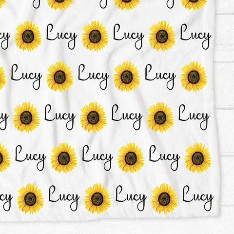 Minky fleece pram cot single bed blanket with white background and yellow sunflowers personalised with the name Lucy